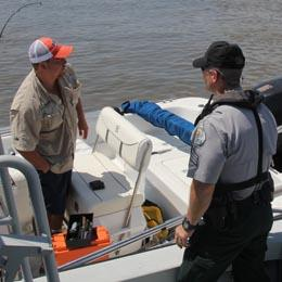 Ranger talking with boater