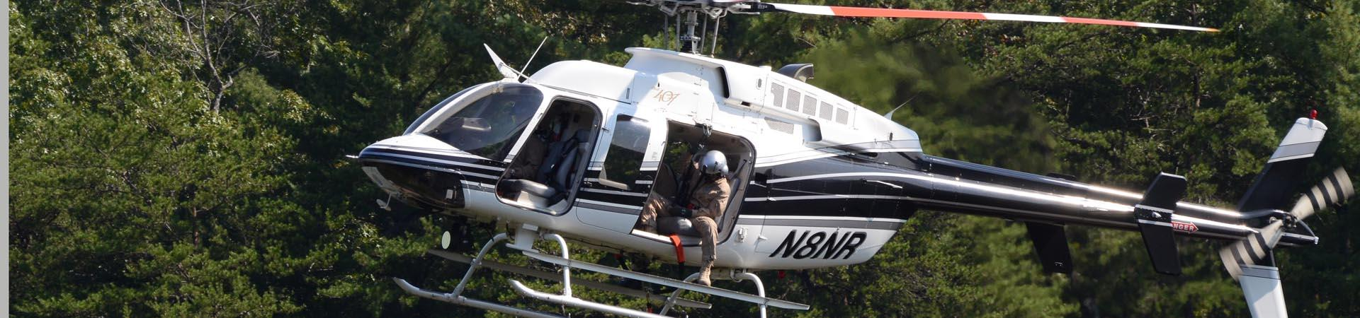 DNR helicopter in long-line rescue training
